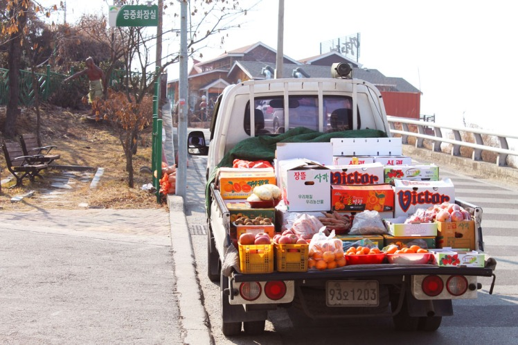 Truck that drives around town broadcasting its fresh produce.