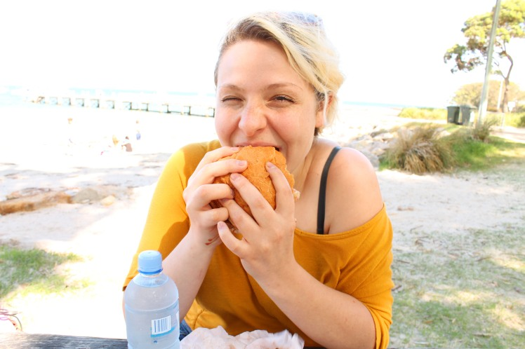 Me struggling to eat my burger amid the daily dose of giggle its giving me.
