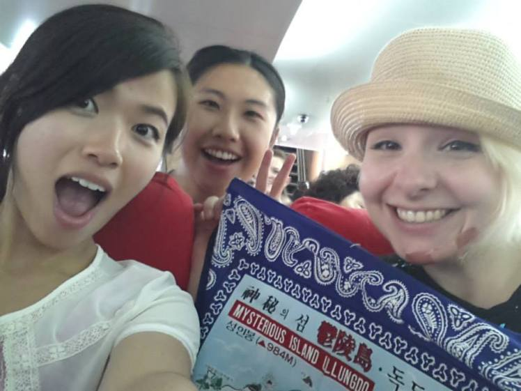 Souvenirs make everything better. Claire and Arlene, and me with a nasty spider bite on my chin. Selfie by Claire.