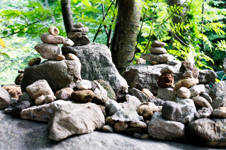 Wish stone piles that hikers build as they walk past.