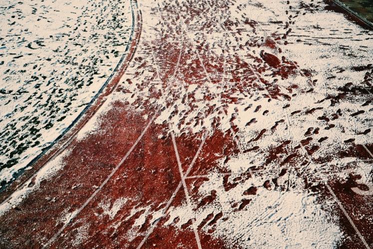 Footprints treading up the school's running track.