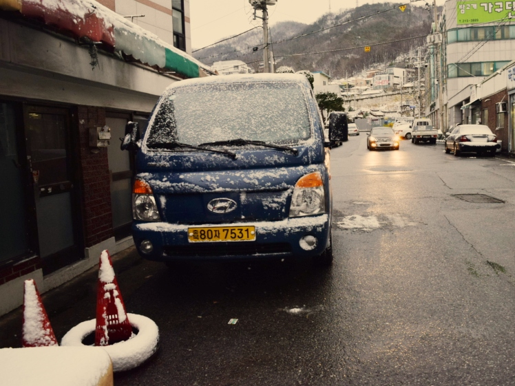 Classic blue truck pretty much every farmer in Korea owns smattered with snow.