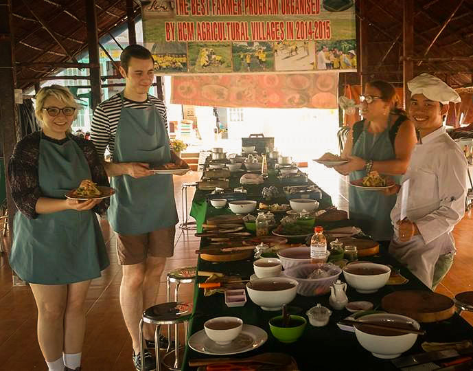Us showing our beautiful displays of salad. Photo by HCM Cooking Class.