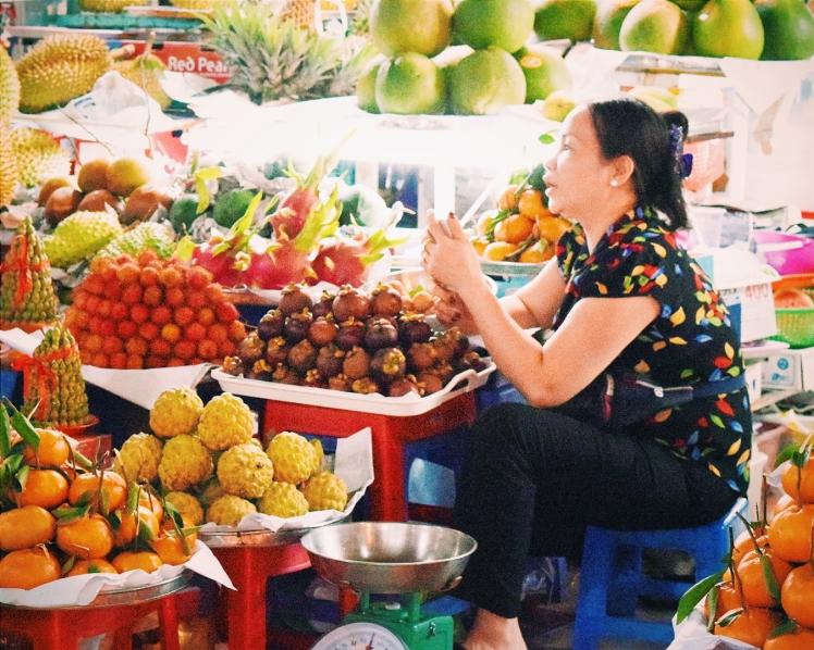 Woman selling her fresh fruit.