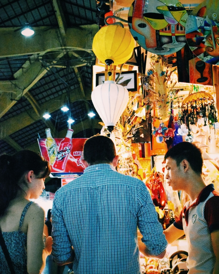 Couple bargaining with a vendor.