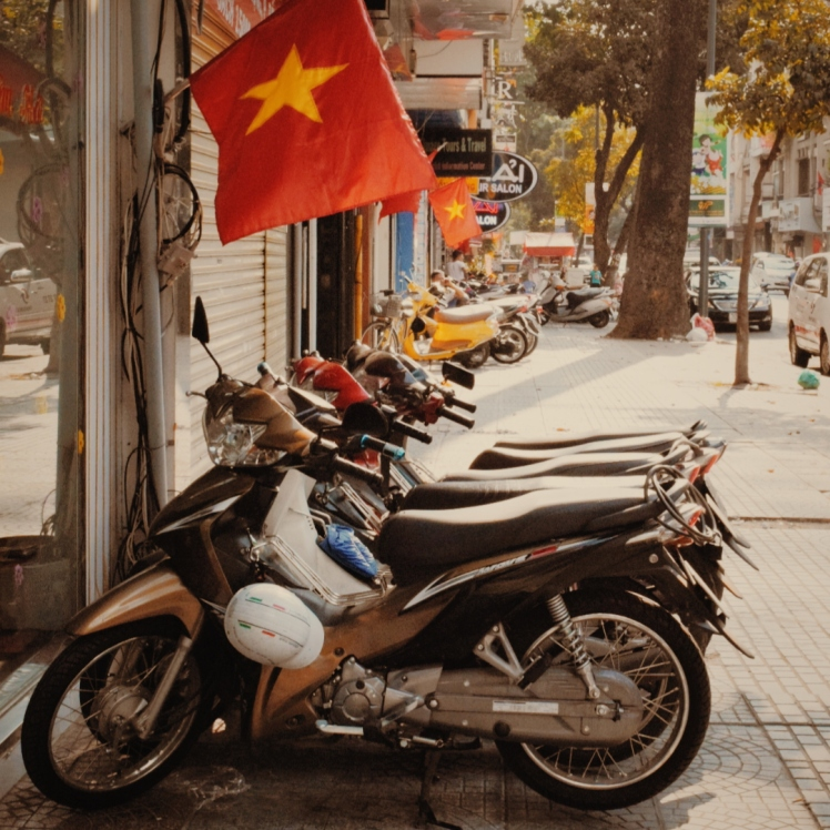 Scooters under the national flag - about as Vietnamese as you can get.