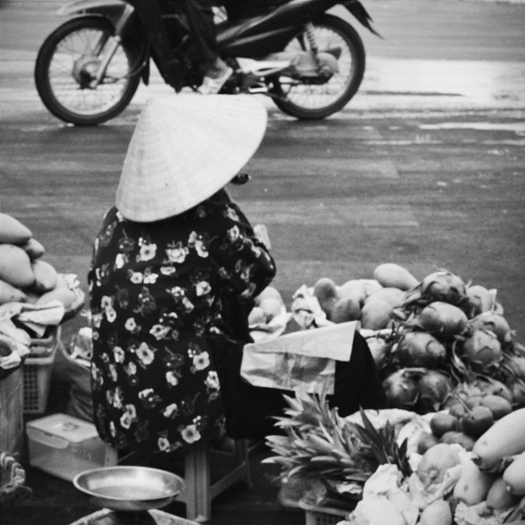 Elderly vendor selling her wares.
