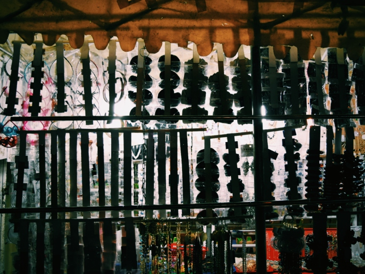 Market stall strung with its many wares.