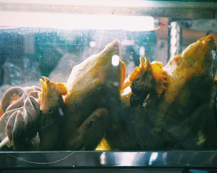 Plucked and prepared chickens ready to be cooked up at a moment's notice at a food stall.