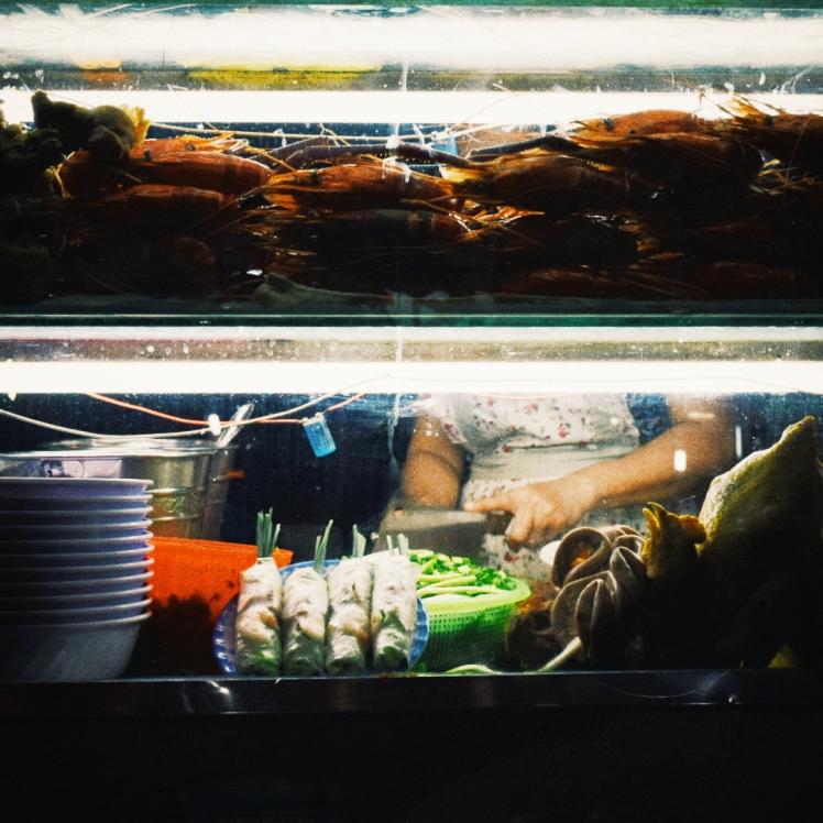 Woman preparing food at her stall.