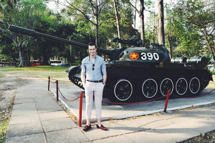 Ricky outside the War Crimes Museum with a tank.