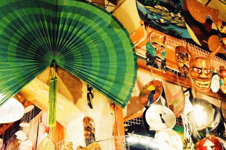 Fan display with masks and other assorted goods.