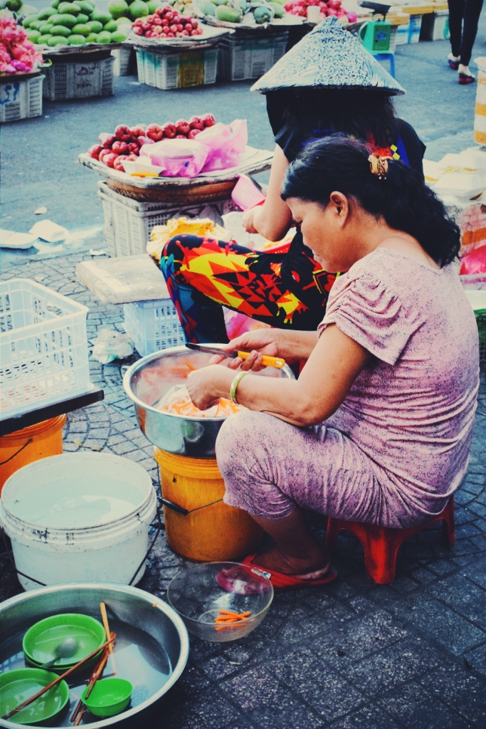 Women preparing ingredients for their street food stall.