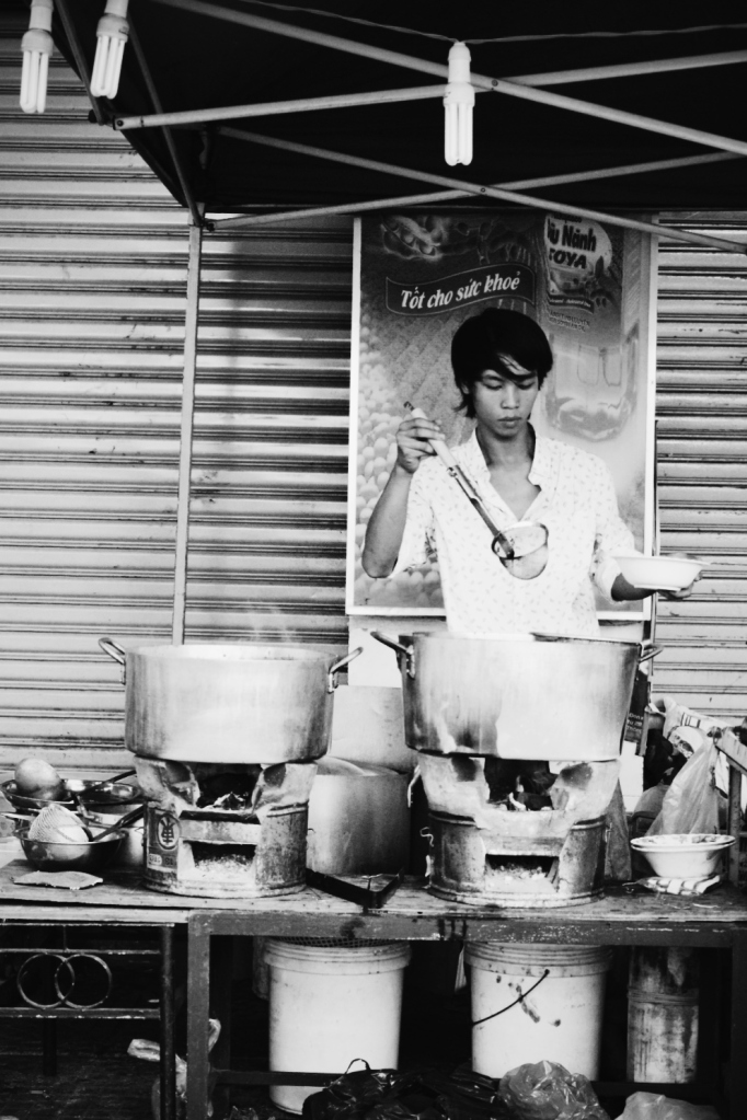 Vietnamese street food stall. He was serving up our order at at this moment.