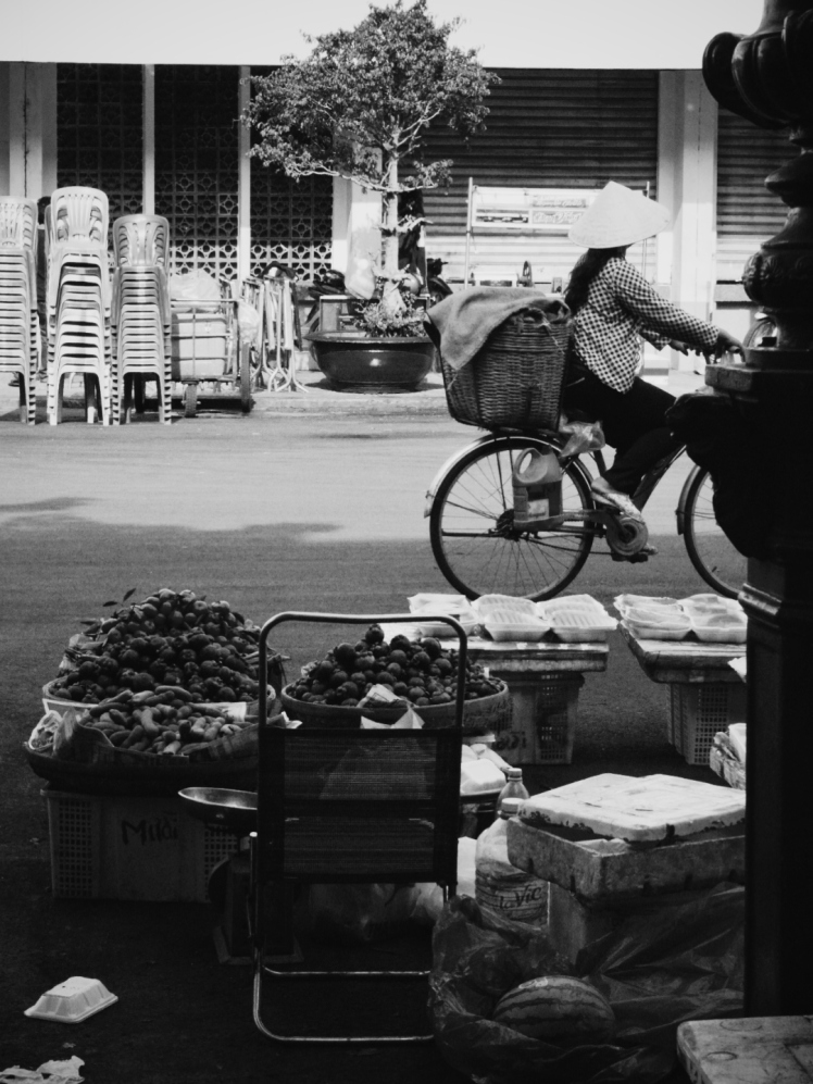 Bicycles were the second most popular form of transport after scooters. Here's a Vietnamese woman running her errands.