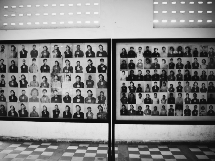 Rooms were full of these photographs making up hundreds if not thousands of faces of the dead.
