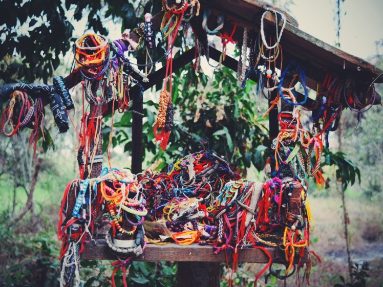 Spirit house adorned lovingly with bracelets.