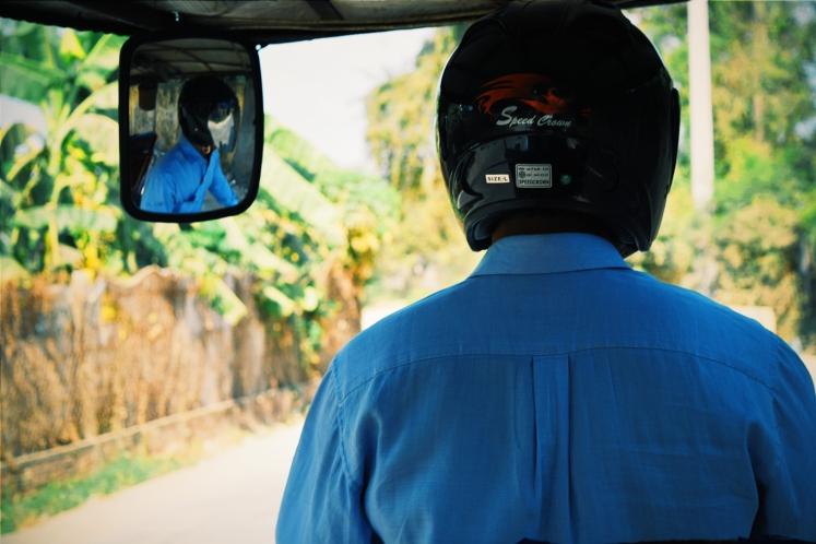 Mr. Kenny driving us in his tuktuk.