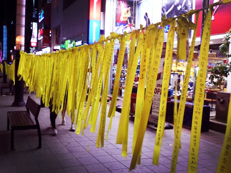 Memorial ribbons full of written messages.