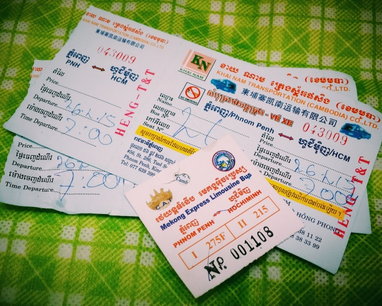 Bus tickets from Phnomn Penh to Ho Chi Minh with luggage tag.