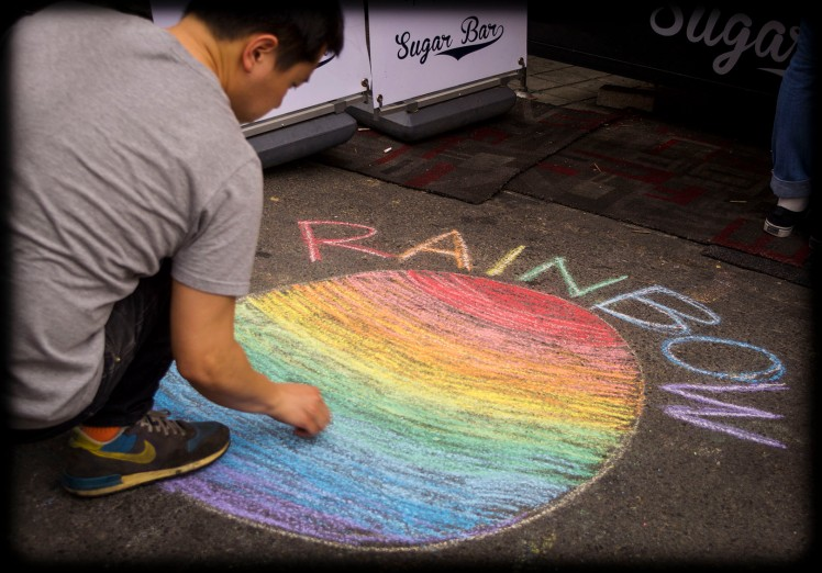 Rainbow chalk advertisement for the Sugar Bar cotton candy stand.
