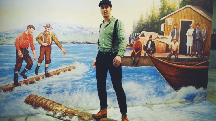 Authentic lumberjack with those suspenders, log driving like a pro.