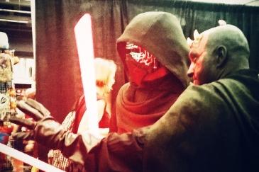 Star Wars cosplayers: Kylo Ren and Darth Maul.
