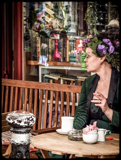 2016 Jack in the Green Costumed Woman Smoking Cigarette Front of Cafe small